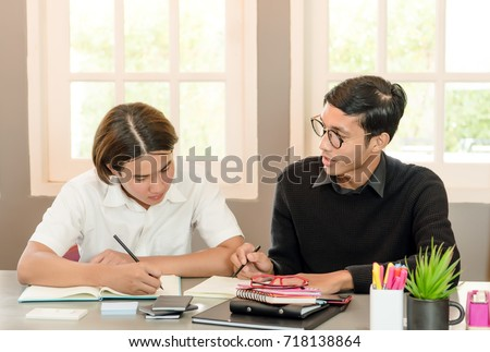 Teenage Boy Studying With Home Tutor