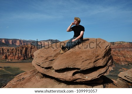 Teenage boy talking on a cell phone in Zion National Park, Kolob section