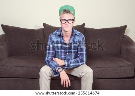 Teenage boy wearing glasses and hat, instagram filter. - stock photo