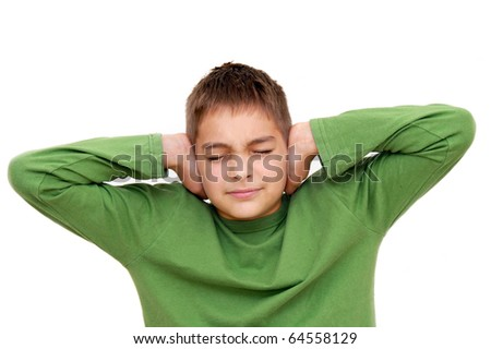 teenage boy with arms on ears and closed eyes isolated on white