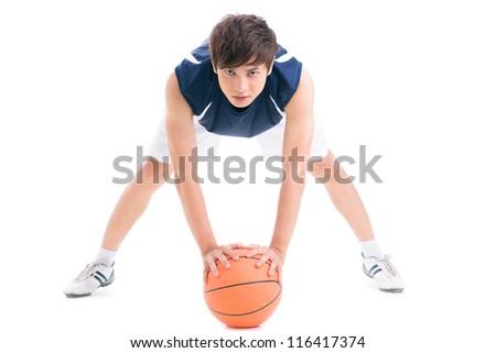 Teenage boy with basketball - stock photo