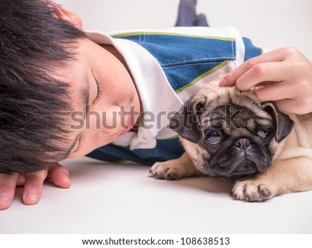Teenage Boy with Puppy
