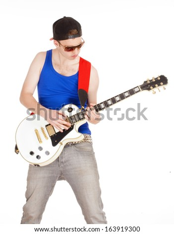 Teenage Boy with Sunglasses Playing Electric Guitar - Isolated on White
