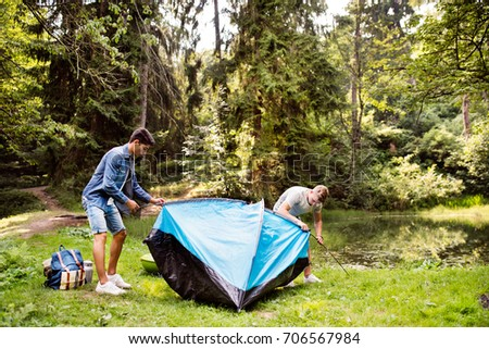 Teenage boys pitching a tent at the lake in forest. : guy pitching a tent - memphite.com