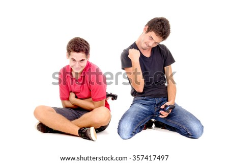 teenage boys playing videogames isolated in white