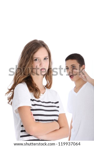 Teenage brother and sister arguing with the girl looking angry and fed up while the boy admonishes her pointing an accusatory finger - stock photo