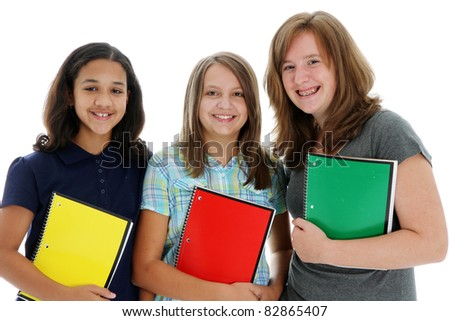 Teenage children in colorful shirts against a white background