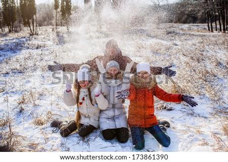 teenage children playing snowballs. - stock photo