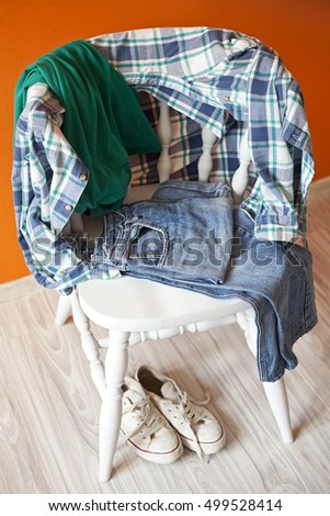 teenage clothes on a chair