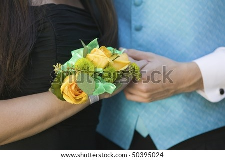 Teenage couple holding hands, close-up of hands - stock photo