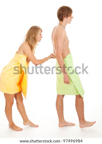 teenage couple in bright towels, white background - stock photo