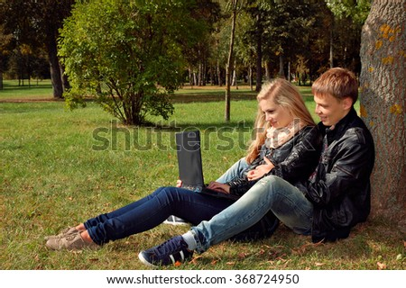 teenage couple studying outdoors, teens lifestyle and college - stock photo