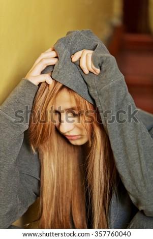 Teenage depressed woman sitting on stairscase. - stock photo