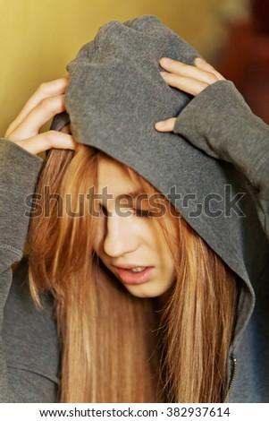 Teenage depressed woman sitting on stairscase - stock photo