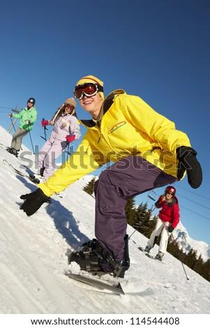 Teenage Family On Ski Holiday In Mountains - stock photo