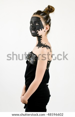 Teenage fashion girl painted with black makeup and black dress on white background