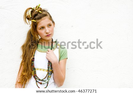 Teenage fashion girl showing off clothes and jewelry