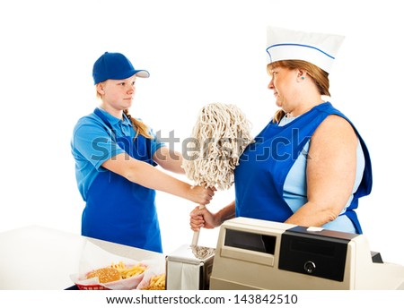 Teenage fast food manager makes an adult woman mop up.  white background. - stock photo