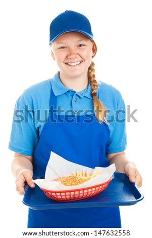 Teenage fast food worker serving a hamburger and french fries.  Isolated on white.   - stock photo