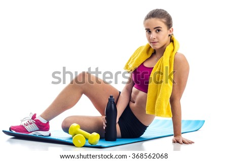 Teenage girl after fitness training - stock photo