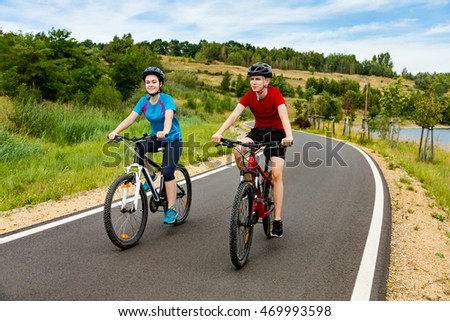 Teenage girl and boy cycling