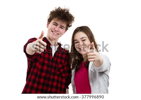 Teenage girl and boy showing OK sign isolated on white background  - stock photo