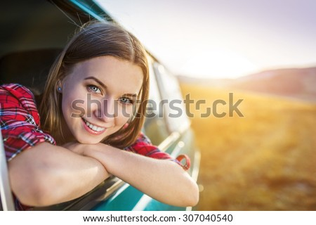 Teenage girl and her friends on a road trip on a summers day - stock photo