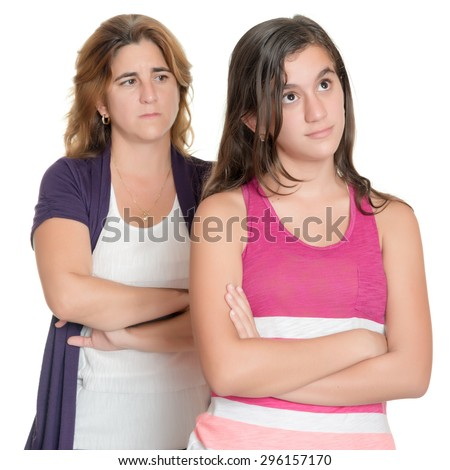 Teenage girl and her sad mother angry at each other isolated on white - stock photo