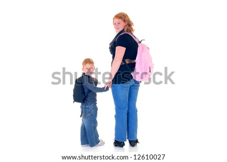 Teenage girl and young boy  casual dressed, backpack on shoulders.  White background.