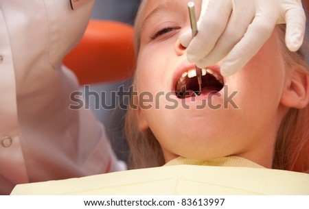 Teenage girl at a dentist. - stock photo