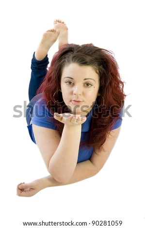 teenage girl blowing a kiss on a white background