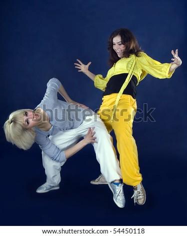 Teenage girl dancing hip-hop in the darkness - stock photo