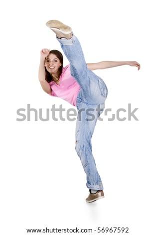 Teenage girl dancing hip-hop over white - stock photo