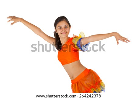 Teenage girl dancing with Latin American clothing on white background.