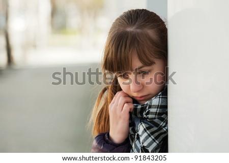 Teenage girl daydreaming - stock photo