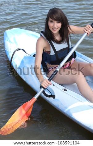teenage girl doing canoe - stock photo