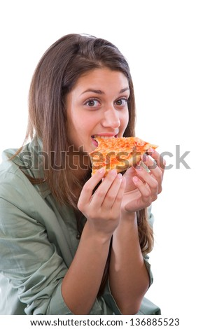 teenage girl eating pizza