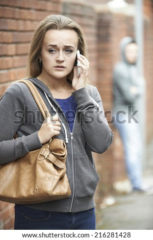 Teenage Girl Feeling Intimidated As She Walks Home - stock photo