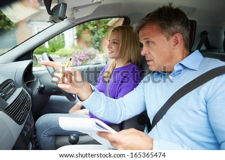 Teenage Girl Having Driving Lesson With Instructor - stock photo