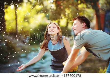 Teenage girl having fun outside. Young couple together. - stock photo