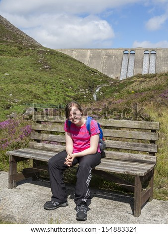 teenage girl hiking in the mournes wearing rucksack - stock photo