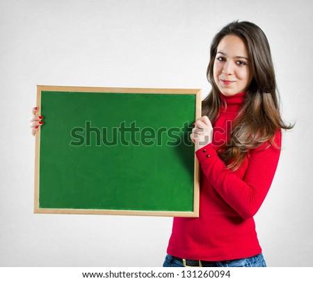 Teenage girl holding a blackboard - stock photo