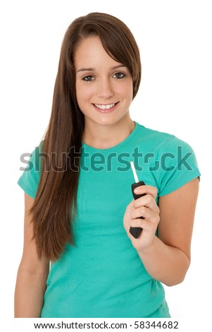 Teenage girl holding car key - stock photo
