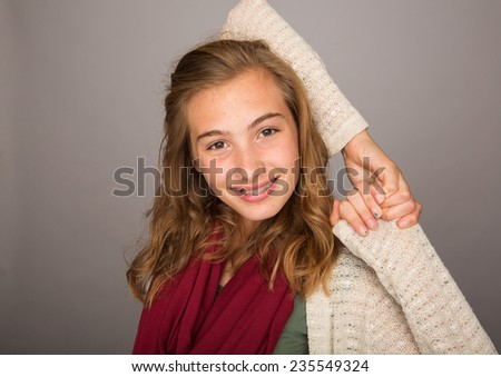 teenage girl holding her arms behind back - stock photo