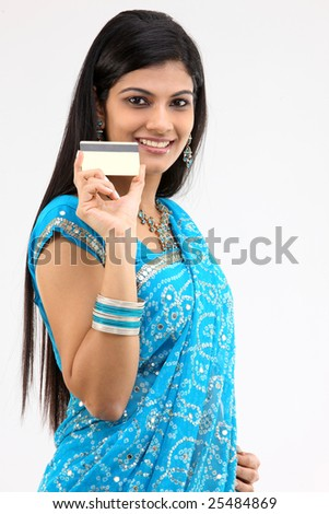 teenage girl in blue sari holding credit card