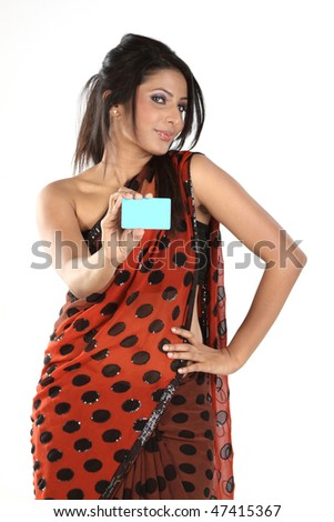 Teenage girl in dots sari with blue credit card - stock photo