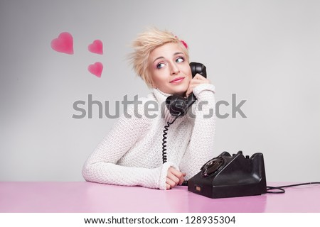 teenage girl in love speaking with her boyfriend on the phone - stock photo