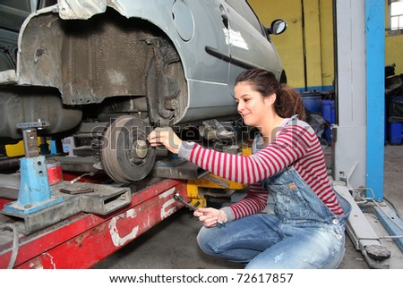 Teenage girl in mechanical professional training - stock photo