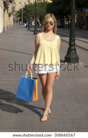 teenage girl in the city center with shopping bags