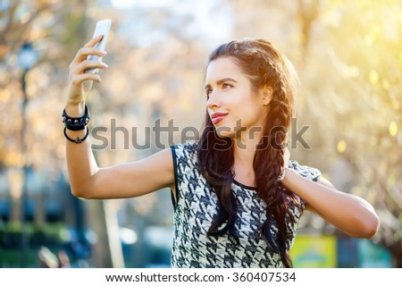 Teenage girl in the city with the smartphone - stock photo